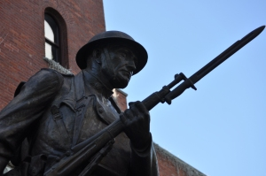 """The Doughboy"" stands at the ready in front of the Eighth Avenue Armory."